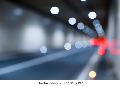 Interior of an urban tunnel without traffic from - light bokeh