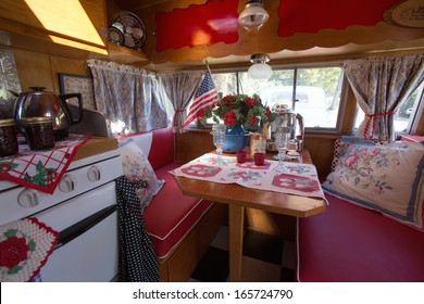 Interior view of breakfast table in a vintage trailer at the 4th Annual Vintage Trailer Bash, Flying Flag RV Resort, Buellton, California
