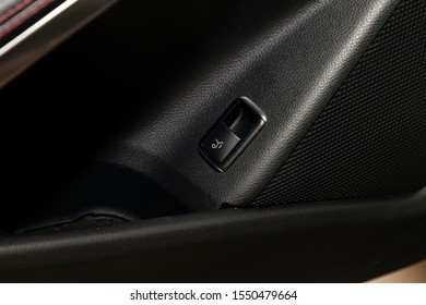 Interior view with electric trunk adjustment button of luxury very expensive new beige car after cleaning in the vehicle repair workshop. Auto service industry