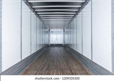 Interior view of empty semi truck dry van commercial trailer