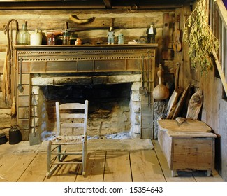 Interior view of an interior fireplace and living room from the 19th century.