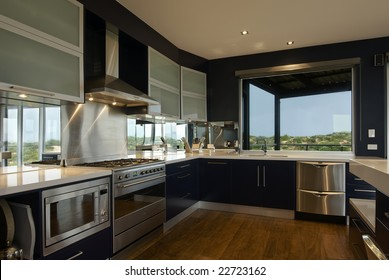 An interior view of a large, deluxe family kitchen