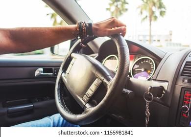 interior view of a man driving his car