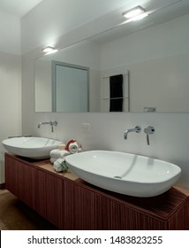 interior view of a modern bathroom foreground on the washbasin
