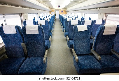 An interior view of a modern intercity train in China, daytime,no flash.