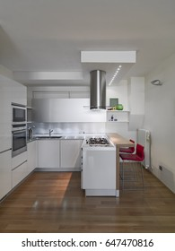 interior view of a modern kitchen with kItchen island and wooden floor