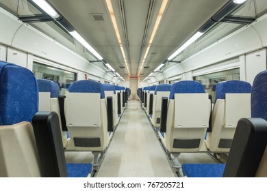 Interior view of a modern train with nobody