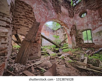 Interior view of the old abandoned St. Nicholas Church ruins in Estonia. Green forest covering the beauty of this ancient ruined building.