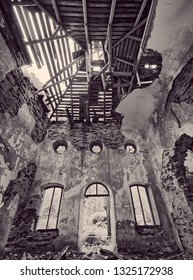Interior view of the old abandoned St. Nicholas Church ruins in Estonia. Green forest covering the beauty of this ancient ruined building. Sepia color effect.