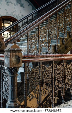 Bon An Interior View Of An Ornate Staircase With Cast Iron Detailing And  Woodwork In An Abandoned