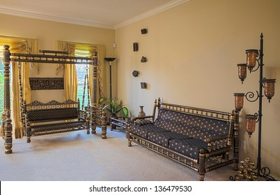 Interior view of a room with traditional Sankheda furniture from Western India