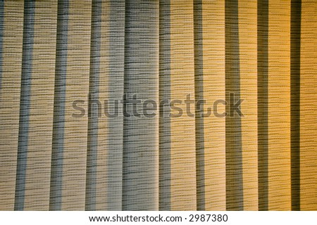 Interior view of venetian blinds closed near sunset
