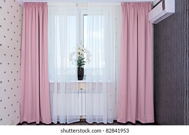 Interior view of window with curtains in bedroom