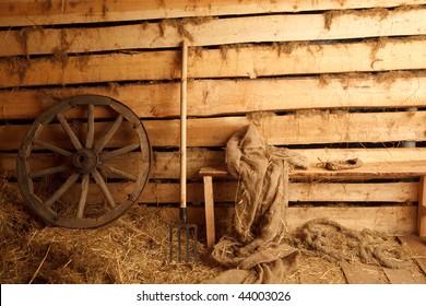 Interior of village building. Wheel, pitchfork, bench, cloth, bast shoe.