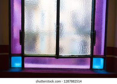 interior vintage purple and blue glass window, on historical building staircase