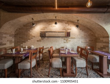 Interior of vintage restaurant, tables ceiling and brick wall