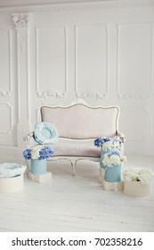 Interior with vintage sofa and blue flowers