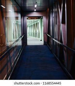 Interior walkway of a metallic jet bridge isolated unique photograph