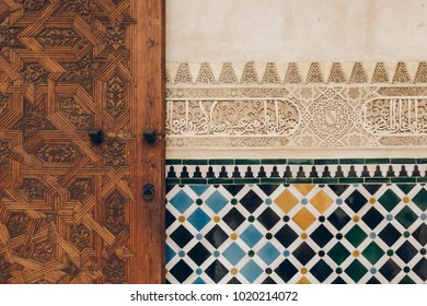 Interior wall decorated with wood door, azulejos style, Alhambra Granada Spain