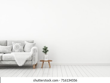 Interior wall mock up with velvet sofa, pillows, plaid and pine branch in vase on empty white background. 3D rendering.