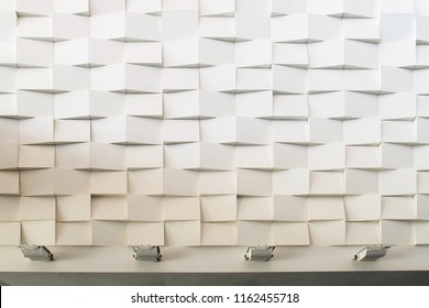 interior wall which has the staggered pieces of white material with surface mounted uplight