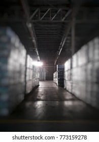 Interior of warehouse. Rows of shelves with paper