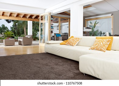 Interior of a well designed home's living room with garden views.