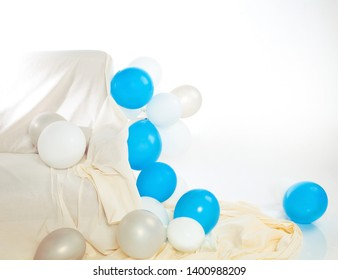 Interior with white and blue balloons and sofa (background for party, with space for your text or logo)