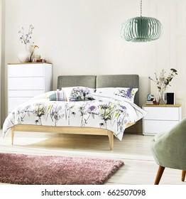Interior of white cozy bedroom. Modern Architectural Interior Design Bedroom