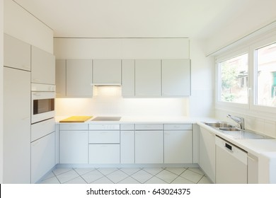 Interior of white kitchen with nobody inside.