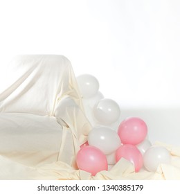 Interior with white and pink balloons and sofa