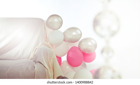 Interior with white and pink balloons and sofa (background for party, with space for your logo or text)