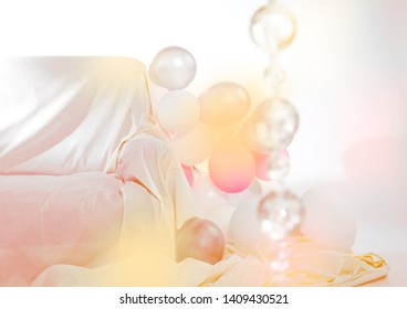 Interior with white and pink balloons and sofa (background for party)