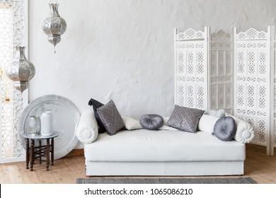 Interior of white room in arabian retro style with beautiful white sofa