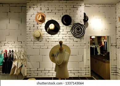a6546e55016 Interior of a women s clothing store selling trendy fashion accessories.