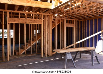 Interior of wood frame home under construction.