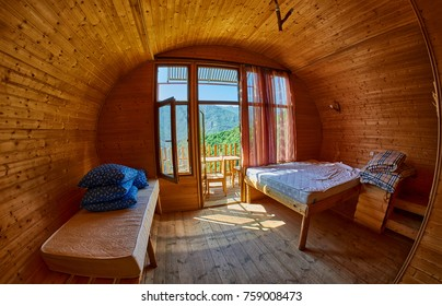 Interior of wooden cottage family room with mountain view