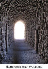 Interiors of Ajloun Castle, view through the stone tunnel. Contrast light. Jordan