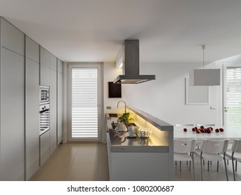 interiors hosts of a modern kitchen with modern tableand and chairs