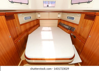 Сabins interiors of motor and sailing yachts and catamarans. Master bedroom on yachts and catmarans