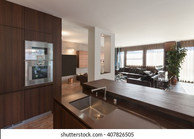 Interiors of new apartment, wooden kitchen modern design