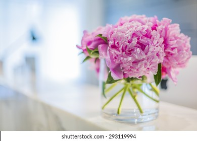 Interiors of a office medical reception with beautiful pink flowers in vase