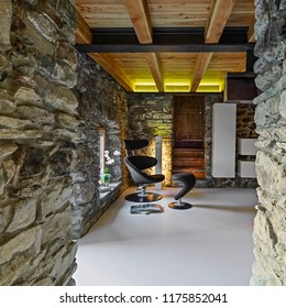 interiors shots of a living room with concrete floor and wooden ceiling
