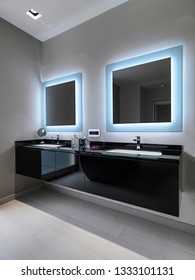 interiors shots of a modern abthroom in the foregorund the sink cabinet