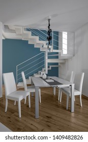 interiors shots of a modern apartment in the foreground the dining table with leather chairs the floor is made of wood in the background the iron staircase