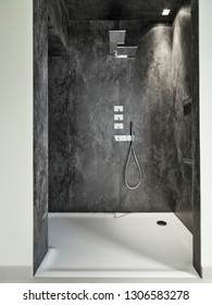 interiors shots of a modern bathroom in the foreground the masonry shower cubicle whose walls are coated of marble