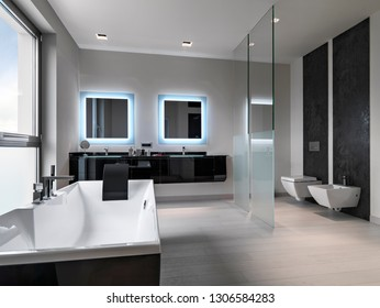 interiors shots of a modern bathroom in the foreground the bathtub in the background the washbasin furniture and the toilet bowl and bidetand