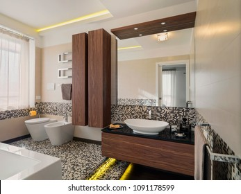 interiors shots of a modern bathroom with mosaic tiles and wooden furniture