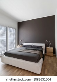 interiors shots of a modern bedroom in the foreground the fabric bed the floor is made of parquet floor