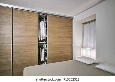 interiors shots of a modern bedroom with wooden wardrobe